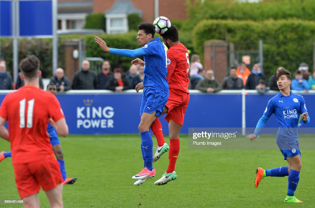 Kairo Mitchell of Leicester City against Joe Gomez of Liverpool during the game between Leicester City and Liverpool: Premier League 2 match at Holmes Park on April 17 2017 in Leicester, United Kingdom