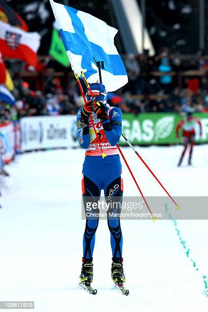 Kaisa Maekaeraeinen of Finland celebrates her first victory in the women's pursuit during the IBU Biathlon World Championshipis on March 6 2011 in...