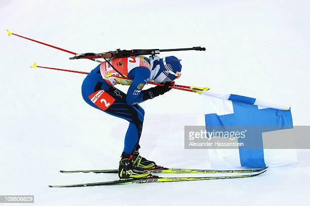 Kaisa Maekaeraeinen of Finland reacts at the finish area after winning the women's 10km pursuit during the IBU Biathlon World Championships at AV...
