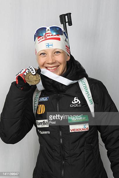 Kaisa Maekaeraeinen of Finnland shows her medal of the IBU Biathlon World Championships Women's Mass Start on March 11 2012 in Ruhpolding Germany