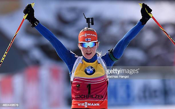 Kaisa Makarainen of Finland celebrates at the finish winning the women's 10 km pursuit event during the IBU Biathlon World Cup on December 14 2014 in...