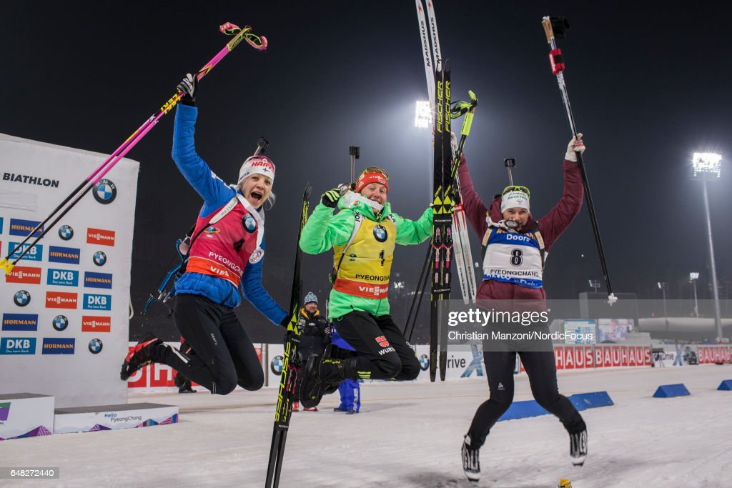 Kaisa Makarainen of Finland, Laura Dahlmeier of Germany and Anais Bescond of France celebrate after the 10 km women's Pursuit on March 4, 2017 in Pyeongchang-gun, South Korea.