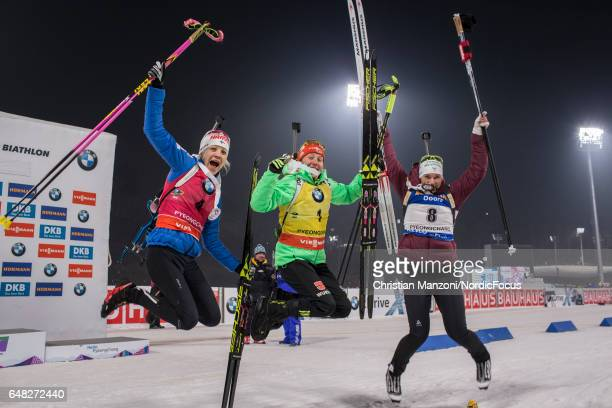 Kaisa Makarainen of Finland Laura Dahlmeier of Germany and Anais Bescond of France celebrate after the 10 km women's Pursuit on March 4 2017 in...