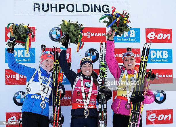 Kaisa Makarainen of FInland second place Dorothea Wierer of Italy first place and Gabriela Soukalova of the Czech Republic third place celebrate on...