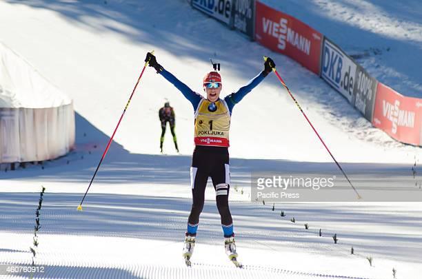 Kaisa Makarainen on the finish line celebrating her first place on Biathlon World Cup 125km Mass Start Women on Pokljuka 2014