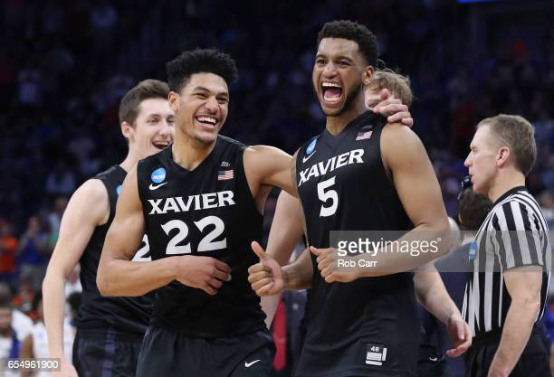Kaiser Gates and Trevon Bluiett of the Xavier Musketeers celebrate their 9166 over the Florida State Seminoles to advance during the second round of...