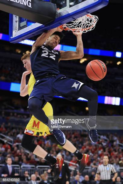 Kaiser Gates of the Xavier Musketeers dunks the ball in the second half against the Maryland Terrapins during the first round of the 2017 NCAA Men's...