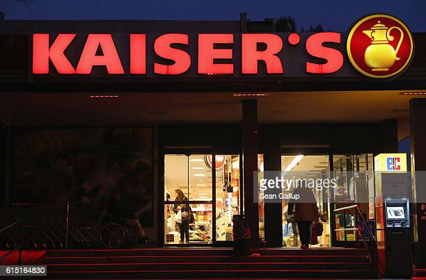 Kaiser's supermarket stands at twilight on October 17 2016 in Berlin Germany Kaiser's Tengelmann the parent company is set to sell all 450 Kaiser's...