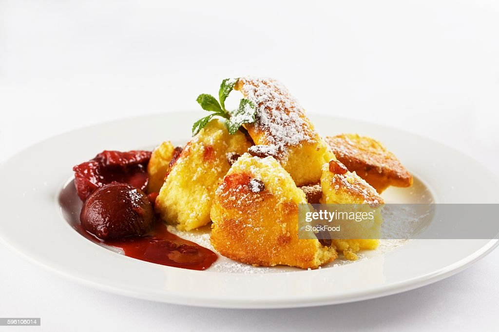 Kaiserschmarren with stewed plums (shredded sugared pancake, Austria)