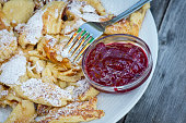 Kaiserschmarrn, a traditional Austrian dessert, with powdered sugar and cranberry marmalade, fork, Stubaital valley, Tyrol, Austria, Europe