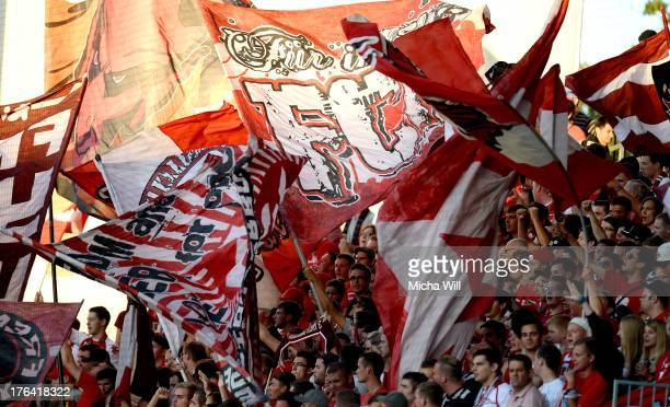Kaiserslautern fans cheer for their team prior to the second Bundesliga match between SpVgg Greuther Fuerth and 1 FC Kaiserslautern at TrolliArena on...