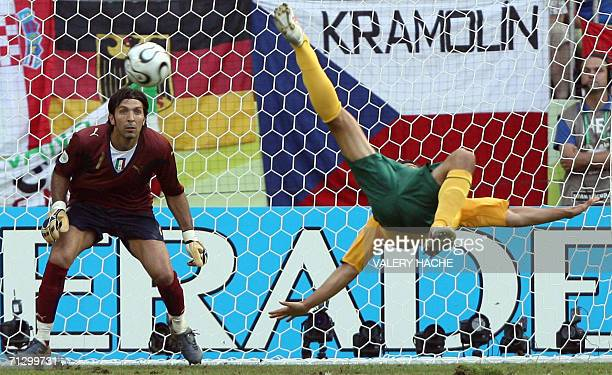 Australian midfielder Tim Cahill tries a scissorkick as Italian goalkeeper Gianluigi Buffon looks on during the round of 16 World Cup football match...