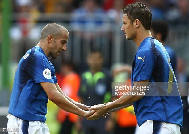 Italian forward Alessandro Del Piero is replaced by Italian midfielder Francesco Totti during the round of 16 World Cup football match between Italy...