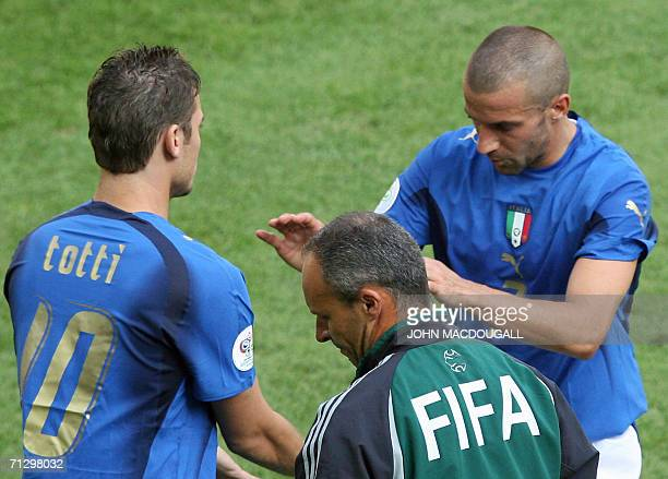 Italian forward Alessandro Del Piero shakes hands with his replacement Italian midfielder Francesco Totti as he comes out in the second half during...