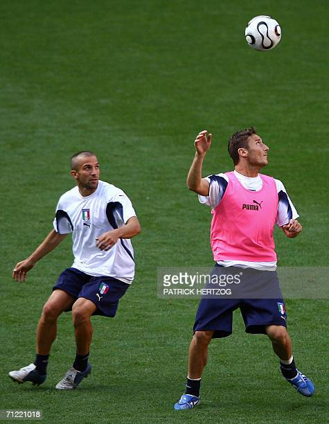 Italian forward Francesco Totti vies for the ball with teammate Alessandro Del Piero during a training session at Kaiserslautern Stadium 16 June 2006...