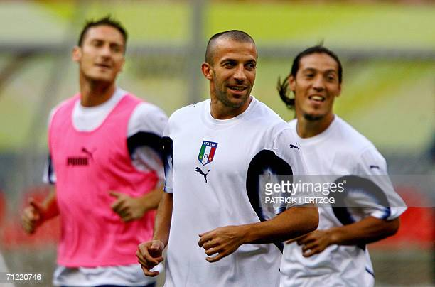 Italian forwards Francesco Totti and Alessandro Del Piero and midfielder Mauro Camoranesi warm up during a training session at Kaiserslautern Stadium...