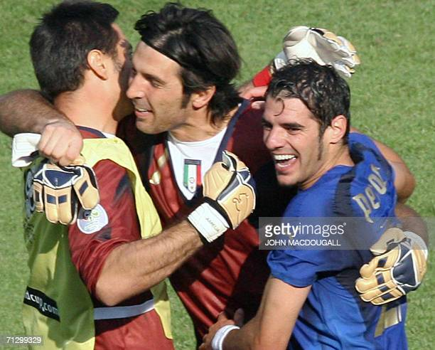 Italian goalkeeper Gianluigi Buffon celebrates with teammates following the round of 16 World Cup football match between Italy and Australia at...
