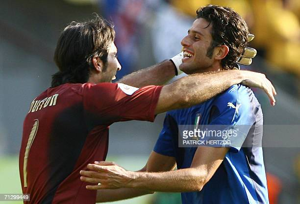 Italian goalkeeper Gianluigi Buffon celebrates with Italian defender Fabio Grosso following their victory in the round of 16 World Cup football match...