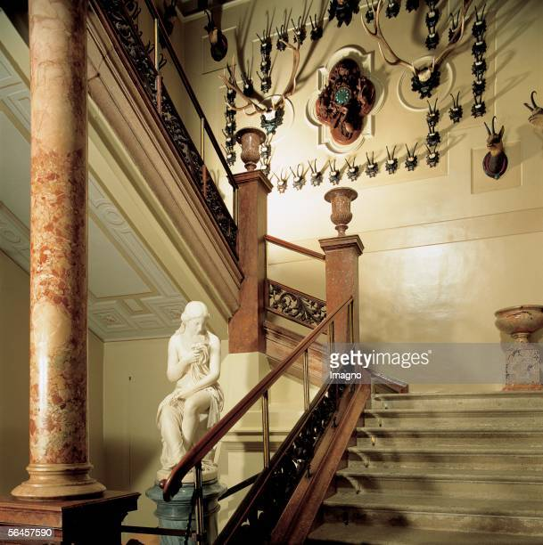 Kaiservilla in Bad Ischl Staircase with hunt trophies Photography by Gerhard Trumler Around 1850 [Kaiservilla in Bad Ischl Stiegenaufgang mit...
