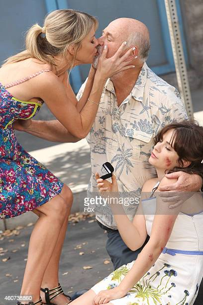 Kaitlin Olosn Rob Reiner and Zooey Deschanel in the 'Julie Beckman's Older Sister' episode of NEW GIRL airing Tuesday Sept 30 2014 on FOX