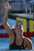 Kaitlin Sandeno waves to the crowd after placing second in the 200 meter butterfly final during the US Swimming Olympic Team Trials on July 11 2004...
