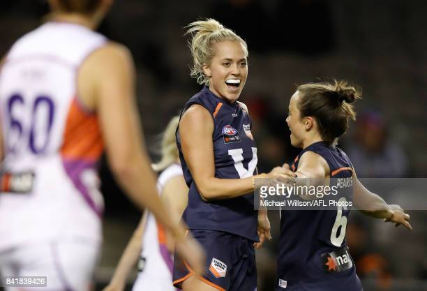 Kaitlyn Ashmore and Daisy Pearce of Victoria celebrate during the AFL Women's State of Origin match between Victoria and the Allies at Etihad Stadium...