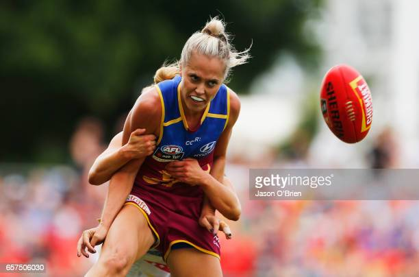 Kaitlyn Ashmore of the Lions is tackled during the AFL Women's Grand Final between the Brisbane Lions and the Adelaide Crows on March 25 2017 in Gold...