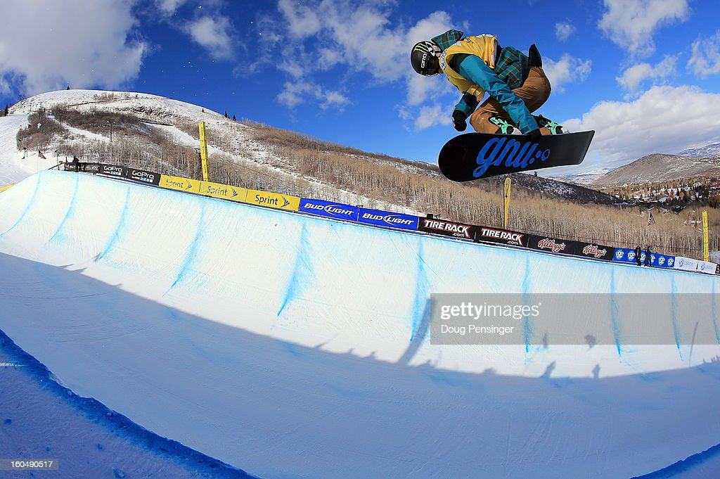 Kaitlyn Farrington spins above the pipe en route to a second place finish in the FIS Snowboard Halfpipe World Cup at the Sprint U.S. Grand Prix at Park City Mountain on February 1, 2013 in Park City, Utah.