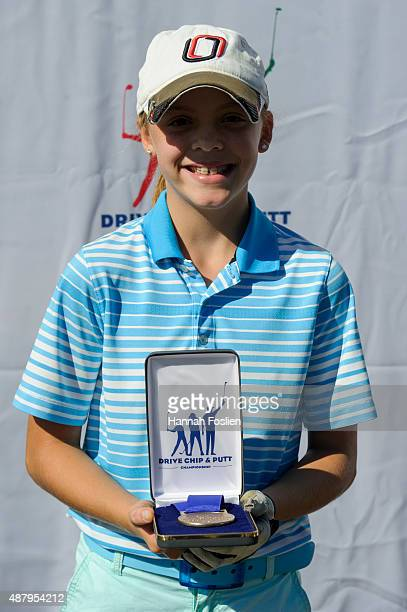 Kaitlyn Hanna poses for a photo after winning first place overall at a Regional Finals for 1213 year old girls at the Drive Chip and Putt competition...