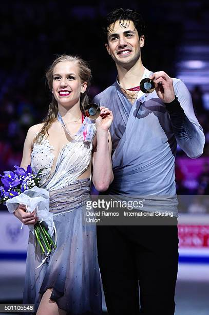 Kaitlyn Weaver and Andrew Poje of Canada and gold medal pose during the Pairs Dance medals ceremony during day three of the ISU Grand Prix of Figure...