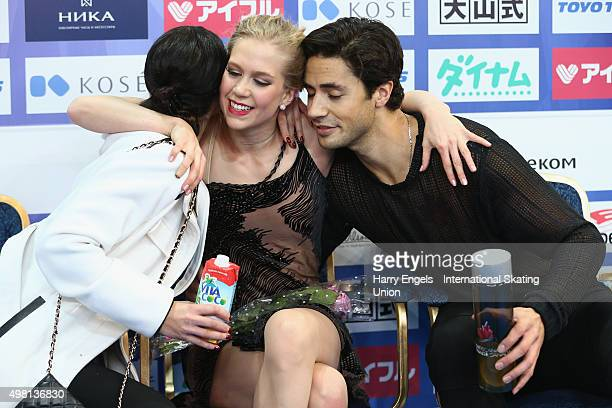 Kaitlyn Weaver and Andrew Poje of Canada celebrate after skating during the Ice Dance Free Dance on day two of the Rostelecom Cup ISU Grand Prix of...