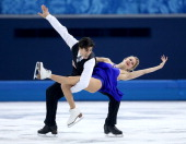 Kaitlyn Weaver and Andrew Poje of Canada compete during the Figure Skating Ice Dance Short Dance on day 9 of the Sochi 2014 Winter Olympics at...
