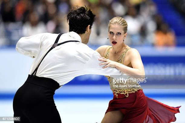 Kaitlyn Weaver and Andrew Poje of Canada compete in the Ice dance free dance during day two of the ISU World Team Trophy at Yoyogi National Gymnasium...