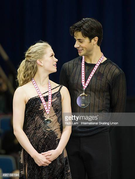 Kaitlyn Weaver and Andrew Poje of Canada on the podium after winning the Ice Dance competition on day two of Skate Canada International ISU Grand...