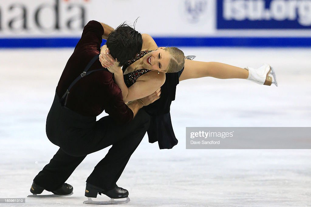 Kaitlyn Weaver (R) and Andrew Poje of Canada skate during the ice dance free program on day two at the ISU GP 2013 Skate Canada International at Harbour Station on October 26, 2013 in Saint John, New Brunswick, Canada.