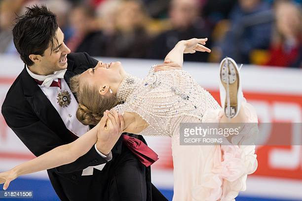 Kaitlyn Weaver and Andrew Poje of Canada skate during the Ice Dance short dance at the ISU World Figure Skating Championships at TD Garden in Boston...