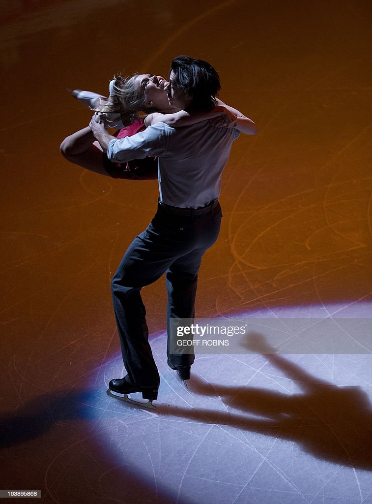 Kaitlyn Weaver and Andrew Poje of Canada skate in the 2013 World Figure Skating Championships Gala in London, Ontario, on March 17, 2013. AFP PHOTO/Geoff Robins
