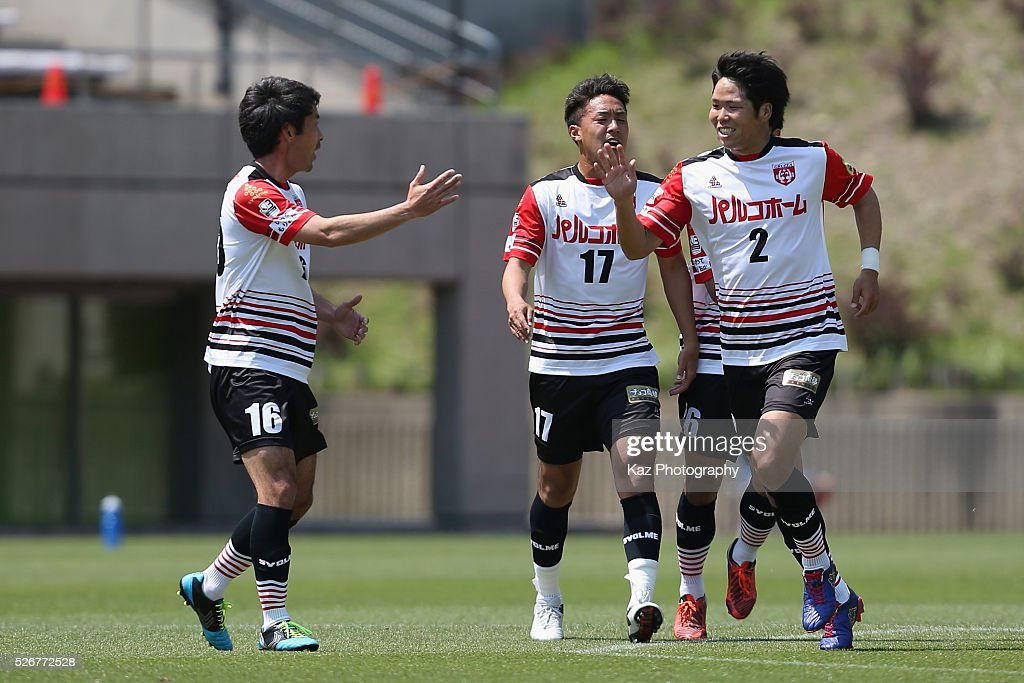 Kaito Kubo (R) of Grulla Morioka celebrates scoring his team's first goal with his team mate Eijiro Mori (L) during the J.League third division match between Fujieda MYFC and Grulla Morioka at the Fujieda Stadium on May 1, 2016 in Fujieda, Shizuoka, Japan.