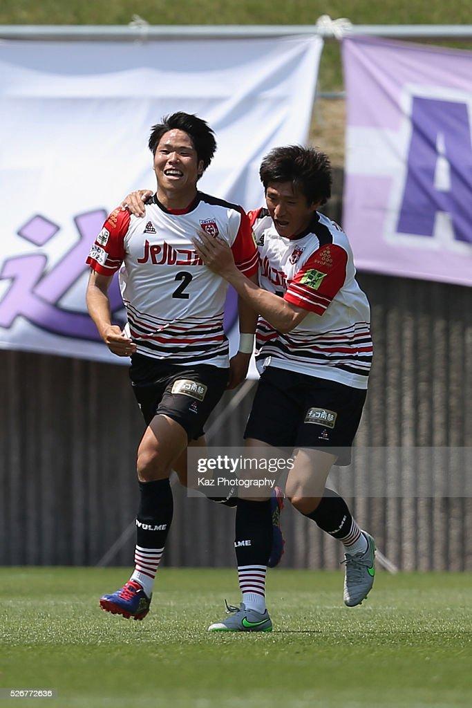 Kaito Kubo (L) of Grulla Morioka celebrates scoring his team's first goal with his team mate Tokio Hatamoto (R) during the J.League third division match between Fujieda MYFC and Grulla Morioka at the Fujieda Stadium on May 1, 2016 in Fujieda, Shizuoka, Japan.