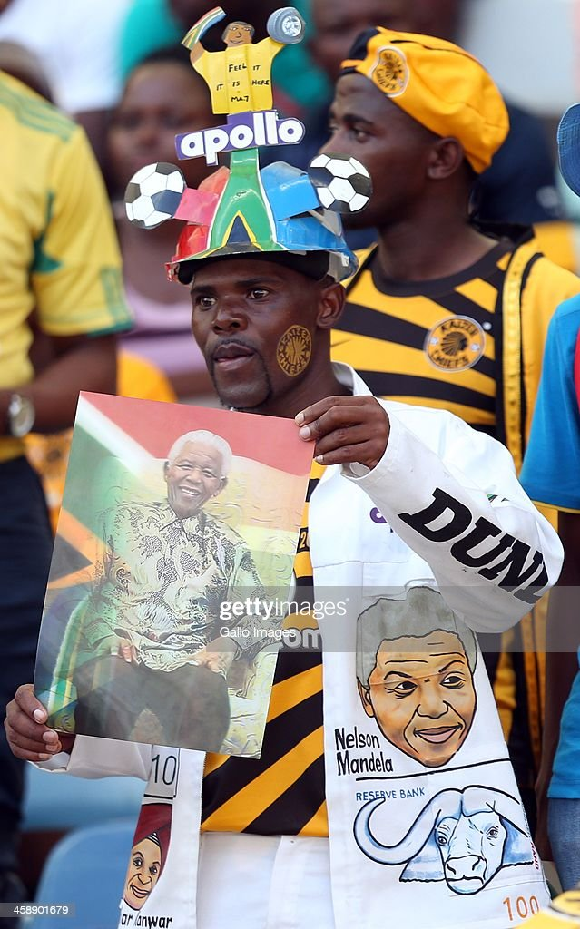 A Kaizer Chiefs fan holds a picture of Nelson Mandela during the Absa Premiership match between AmaZulu and Kaizer Chiefs at Moses Mabida Stadium on December 22, 2013 in Durban, South Africa.