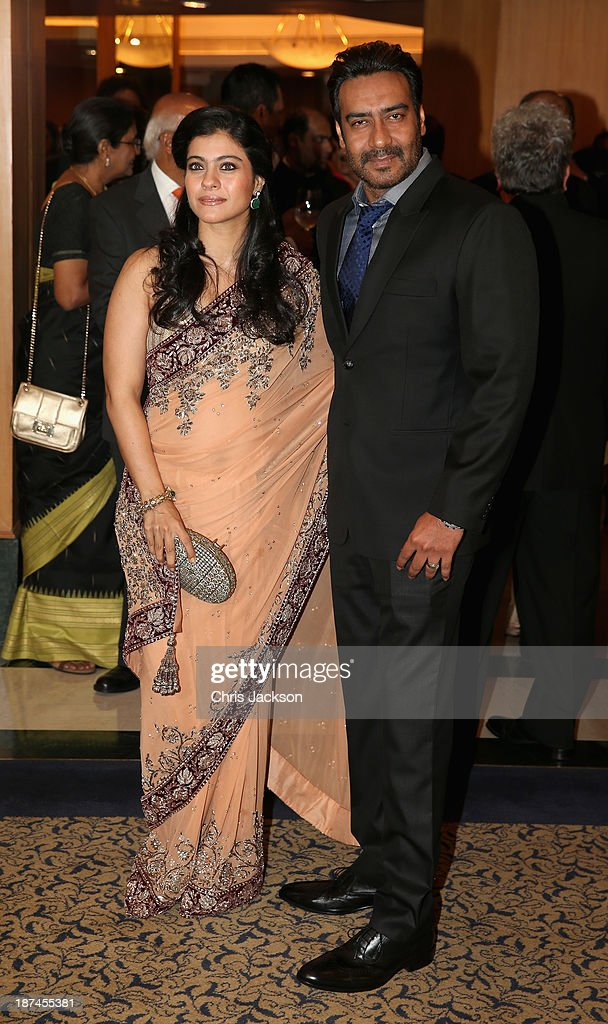 Kajol and <a gi-track='captionPersonalityLinkClicked' href=/galleries/search?phrase=Ajay+Devgan&family=editorial&specificpeople=627271 ng-click='$event.stopPropagation()'>Ajay Devgan</a> at the British Asian Trust Reception on day 4 of an official visit to India on November 9, 2013 in Mumbai, India. This will be the Royal couple's third official visit to India together and their most extensive yet, which will see them spending nine days in India and afterwards visiting Sri Lanka in order to attend the 2013 Commonwealth Heads of Government Meeting.