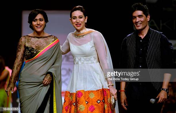Kajol and Krishma Kapoor walk the ramp for designer Manish Malhotra during the Lakme Fashion Week 2013 in Mumbai on March 22 2013