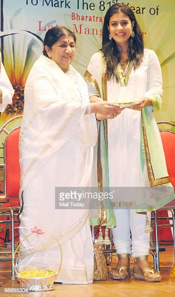 Kajol receives an award from Lata Mangeshkar at the Deenanath Mangeshkar Awards in Mumbai on Sunday April 25 2010