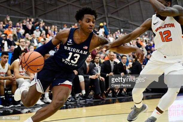 Kajon Brown of the Brigham Young Cougars drives against Myles Stephens of the Princeton Tigers during the first half at L Stockwell Jadwin Gymnasium...