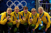 Kajsa Bergstroem Anna Le Moine Cathrine Lindahl Eva Lund and Anette Norberg of Sweden pose with their gold medals after victory over Canada in the...