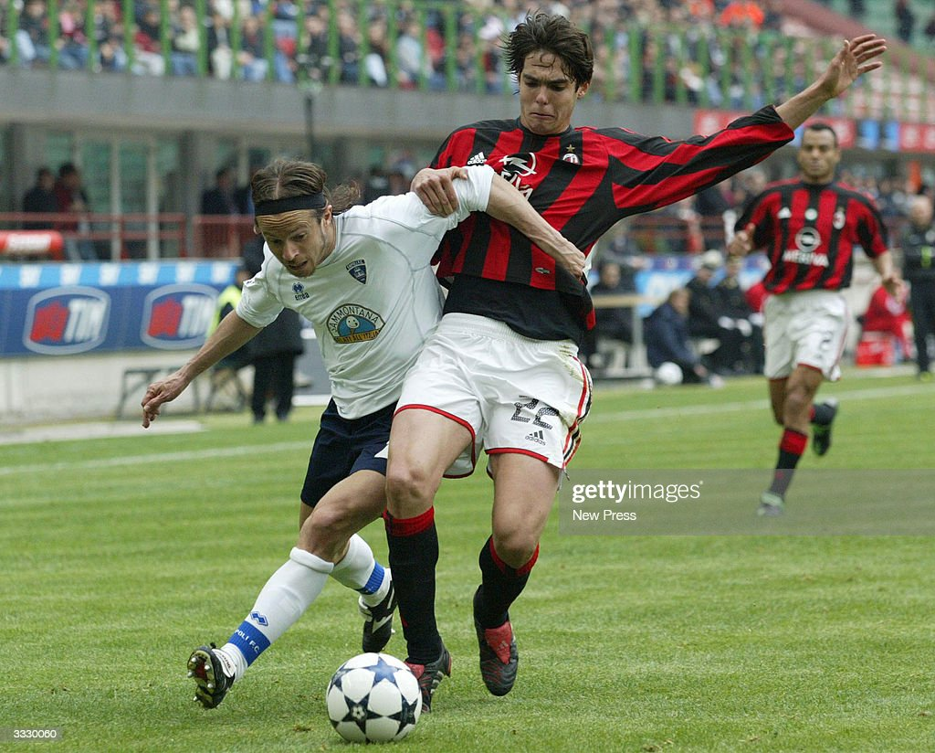 Kaka and Cupi in action during the Serie A match between Milan and Empoli April 10, 2004 in Milan, Italy.