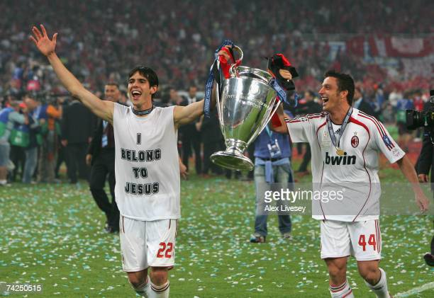 Kaka and Massimo Oddo of Milan celebrate with the trophy following their teams 21 victory during the UEFA Champions League Final match between...