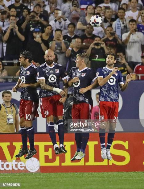 Kaka Jelle Van Damme Bastian Schweinsteiger and Ignacio Piatti leap to try and block a free kick against Real Madrid during the 2017 MLS All Star...