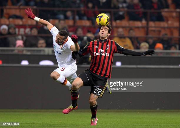 Kaka of AC Milan and Castan of AS Roma compete for the ball during the Serie A match between AC Milan and AS Roma at San Siro Stadium on December 16...