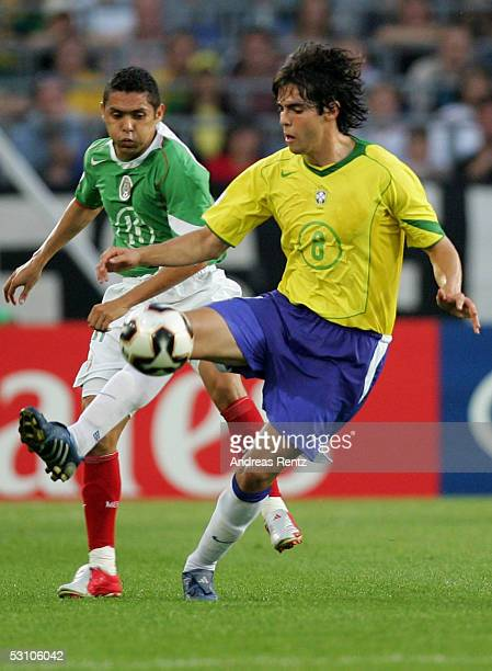 Kaka of Brazil challenges with Ramon Morales of Mexico during the FIFA Confederations Cup 2005 match between Mexico and Brazil on June 19 2005 in...